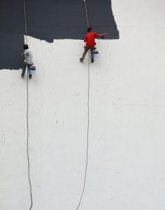 people painting high walls without scaffolding