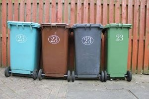image of four wheelie bins