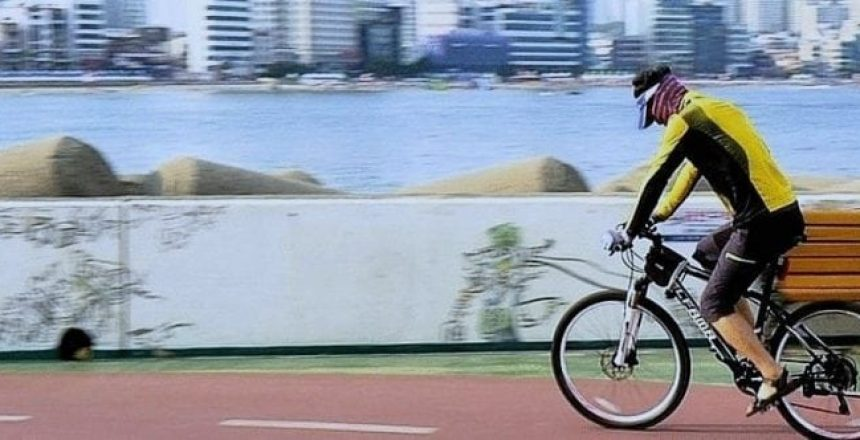 young man riding on the by bike by the river, Keep Staff Healthy