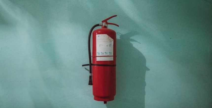 fire extinguisher old green wall, London Office Safe